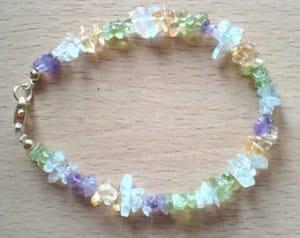 semi-precious gemstone chakra bracelet with citrine peridot amethyst aquamarine crystal